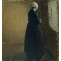 An old woman standing by a window